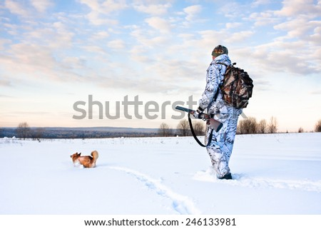 hunter with a dog on a frosty day - stock photo