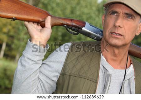 Hunter with a shotgun - stock photo