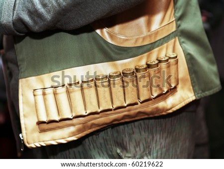Hunter with ammunition belt around his waist - stock photo