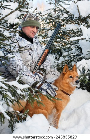 hunter with dog during the rest