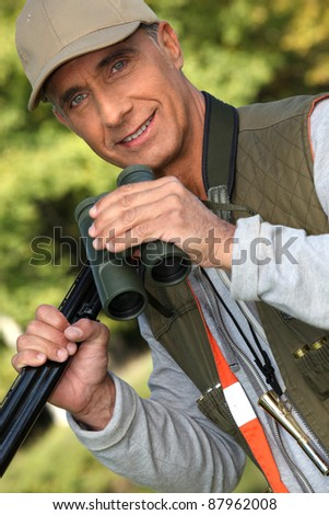Hunter with his binoculars - stock photo