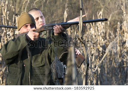 Hunters hunting ducks in wild  - stock photo