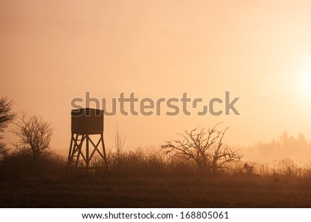 Hunters lookout tower in beautiful morning mist scenery - stock photo