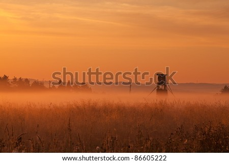 Hunters tower at sunrise in autumn - stock photo