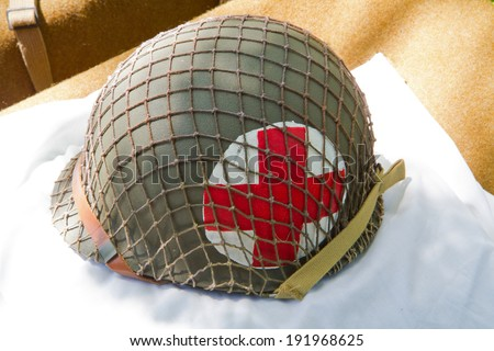 HUNTERSVILLE, NC - MAY 3, 2014:  An American World War II medic helmet on display at Historic Latta Plantation as part of a military reenactment in commemoration of the 70th anniversary of D-Day. - stock photo