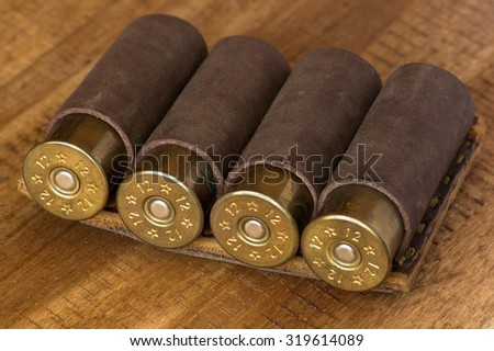 Hunting cartridges in leather ammunition belt - stock photo