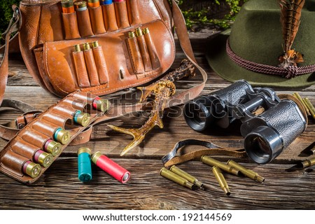 Hunting equipment in a forester lodge - stock photo