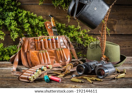 Hunting equipment in a house forester - stock photo