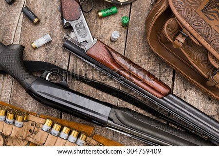 Hunting equipment on old wooden background - stock photo