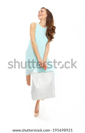 Hunting for bargains - woman shopping .Young, attractive girl in a summer dress with a large bag purchasing  - stock photo
