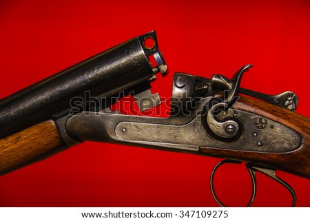 Hunting gun and red backgroung  - stock photo