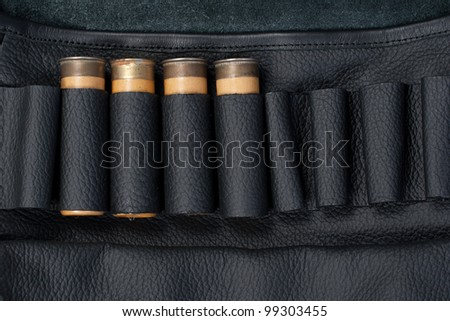 hunting leather bag with ammo isolated on white background - stock photo