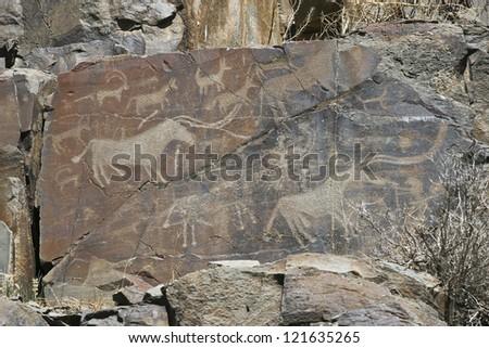 Hunting of prehistoric man - stock photo