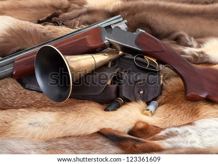 Hunting subjects on background of the fur - stock photo