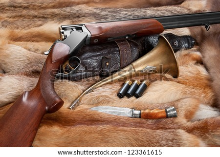 Hunting things on background of the fur - stock photo