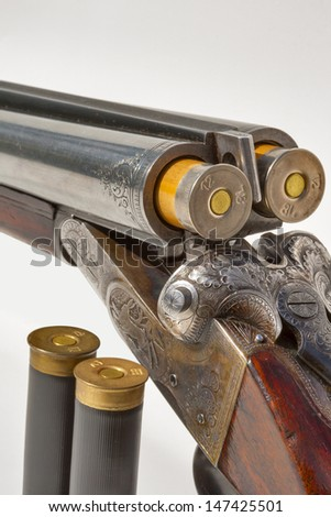 hunting vintage rifle charged with additional cartridges macro - stock photo