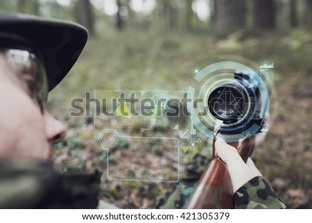 hunting, war, army, technology and people concept - close up of young soldier or sniper holding gun with virtual screen projection and aiming in forest - stock photo