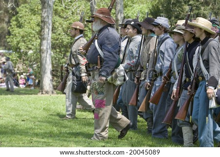 HUNTINGTON BEACH, CA Aug 30:  Civil war re-enactors as Confederate Soldiers marching into battle.