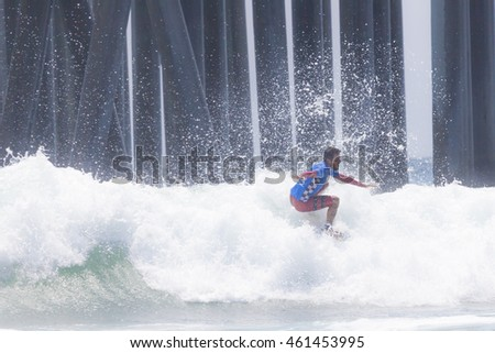 HUNTINGTON BEACH, CA. - JULY 31: Filipe Toledo competing at the Vans US Open of Surfing in Huntington Beach, CA. on July 31 2016.