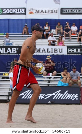 HUNTINGTON BEACH, CA - JUNE 6: Phil Dalhausser to serve at the AVP pro volleyball tournament June 6, 2010 in Huntington Beach, CA