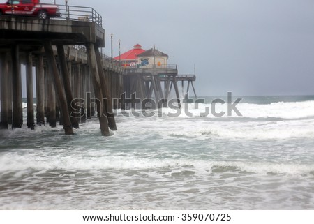 Huntington Beach CA: 1-6-2016, The Huntington Beach pier is pounded by High Surf as the El Nino Storm of 2016 makes landfall and causes flooding and damage all around southern California. - stock photo
