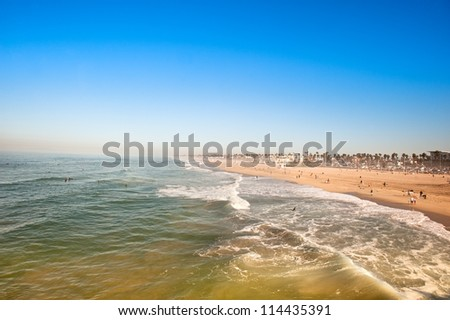 Huntington Beach, California in the morning shows the tides changing during a sunny weekend. - stock photo