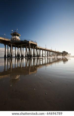 Huntington Beach Pier Low Tide Reflections - stock photo