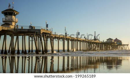 Huntington Beach Pier reflecting on beach - stock photo