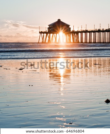 Huntington Beach Pier Sunburst Reflection - stock photo