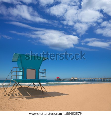 Huntington beach Pier Surf City USA with lifeguard tower in California - stock photo