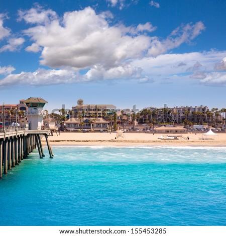 Huntington beach Surf City USA pier view with lifeguard tower and city California - stock photo