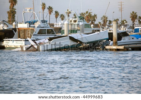 Huntington Harbor California January 19th, 2010: A tornado wreaks havoc and destruction during a freak storm, over turning boats and more - stock photo