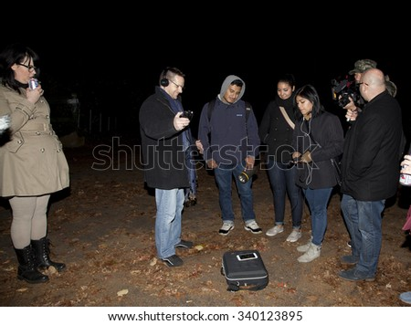 HUNTINGTON, NEW YORK, USA - NOVEMBER 14: Members of the Brooklyn Paranormal Society during investigation of Mount Misery Road in Long Island.   Taken November 14, 2015 in NY. - stock photo