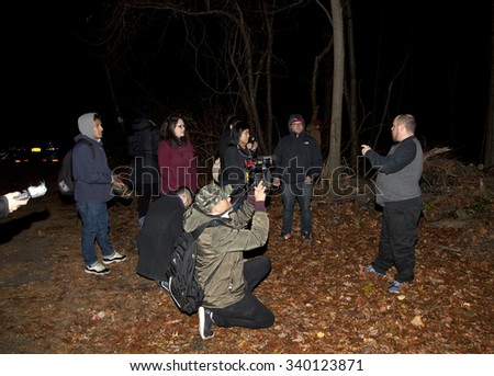 HUNTINGTON, NEW YORK, USA - NOVEMBER 14: Randy talks about the history of Mount Misery road as the Brooklyn Paranormal Society investigate the  location in Long Island.  Taken November 14, 2015 in NY.