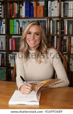 "HUNTINGTON, NY-MAR 15: Kristin Cavallari signs copies of her book ""Balancing in Heels: My Journey to Health, Happiness, and Making it all Work"" at Book Revue on March 15, 2016 in Huntington, New York. - stock photo"