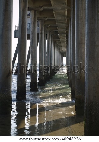huntington pier concrete structure pylons shot from under the pier. - stock photo