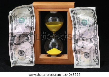 Huorglass and Banknotes - Time is Money - stock photo