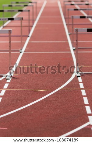 hurdles on race track - stock photo