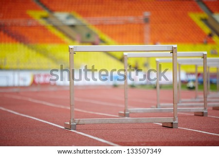 Hurdles on race tracks for obstacle race - stock photo