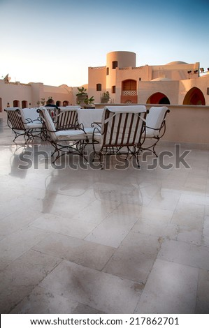 HURGHADA (EGYPT) - CIRCA JULY 2013 - Outdoor Patio Lounge with Tables and Chairs at Hurghada, Egypt - stock photo