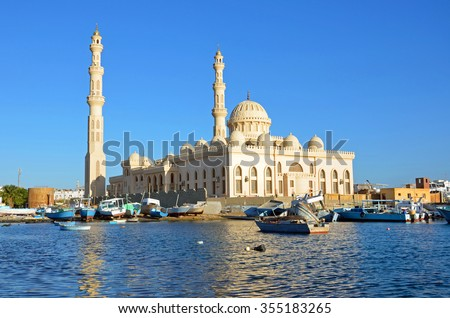 HURGHADA, EGYPT - DECEMBER 5 2015: Port Grand Mosque is one of the most popular landmarks in Hurghada and located at the seaside of Red Sea near fishing market and marina.