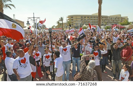 HURGHADA, EGYPT - FEBRUARY 14:  Egyptian crowd celebrates at 'I Love Egypt' party on February 14th 2011. Egypt had recently seen 2 weeks of troubles against the government - stock photo