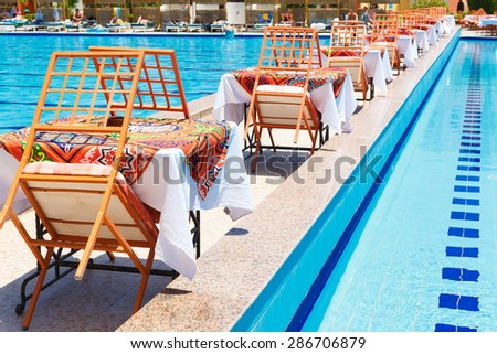 HURGHADA, EGYPT - MAY 20, 2015: Swimming pool with tables for the meal, Arabia Azur Resort