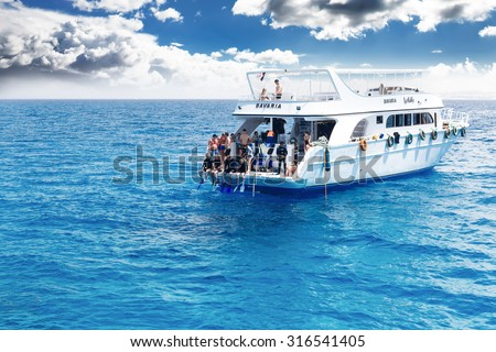 HURGHADA, EGYPT - MAY 19, 2015: Yacht with scuba divers in the Red sea.