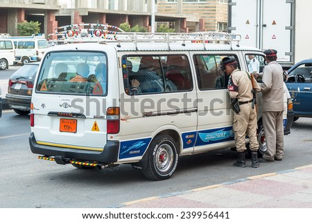 Hurghada, Egypt - November 5. 2006: Egyptian Police Officers check vehicle - stock photo