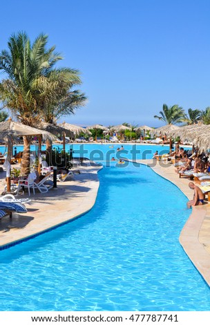HURGHADA,EGYPT - SEPTEMBER 17,2010:Tourists relax by the pool in the hotel