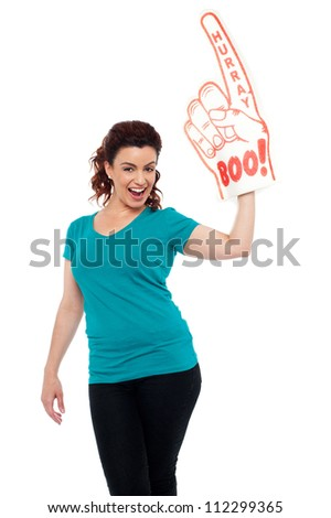 Hurray lets celebrate. Cheerful female fan. All on white background - stock photo