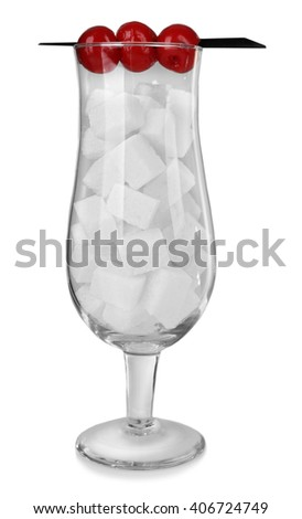 Hurricane glass with lump sugar and cocktail cherries on grey background - stock photo