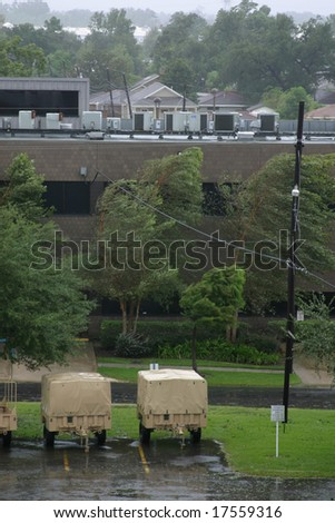 Hurricane Gustav winds and rain batter military vehicles and trees in New Orleans, Louisiana.