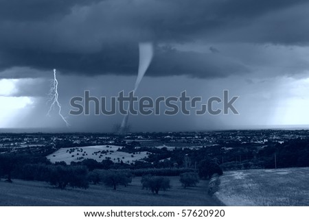 hurricane strikes the city in the morning - stock photo